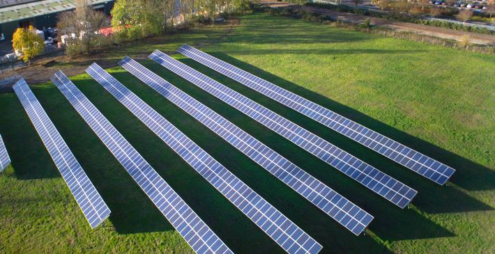 industrial solar panels in field