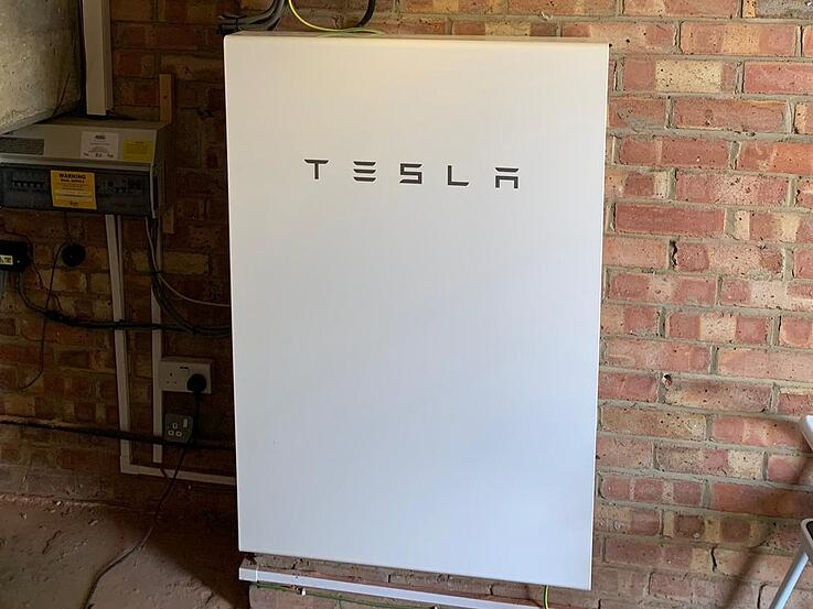 Tesla with Back Up in Garage